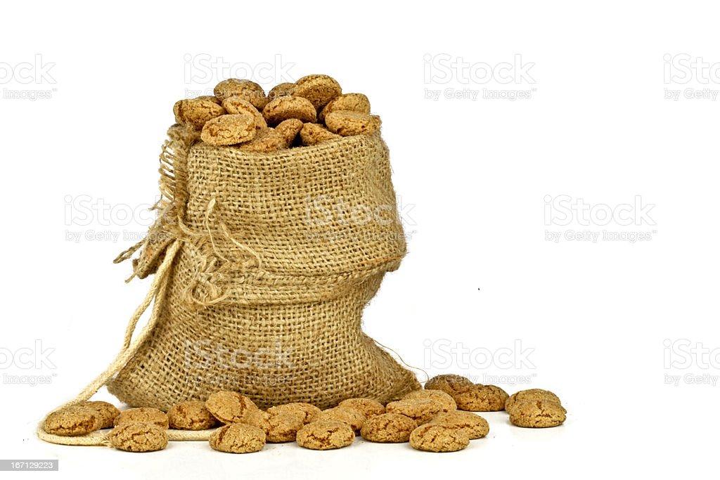 Jute bag full of gingerbread nuts royalty-free stock photo