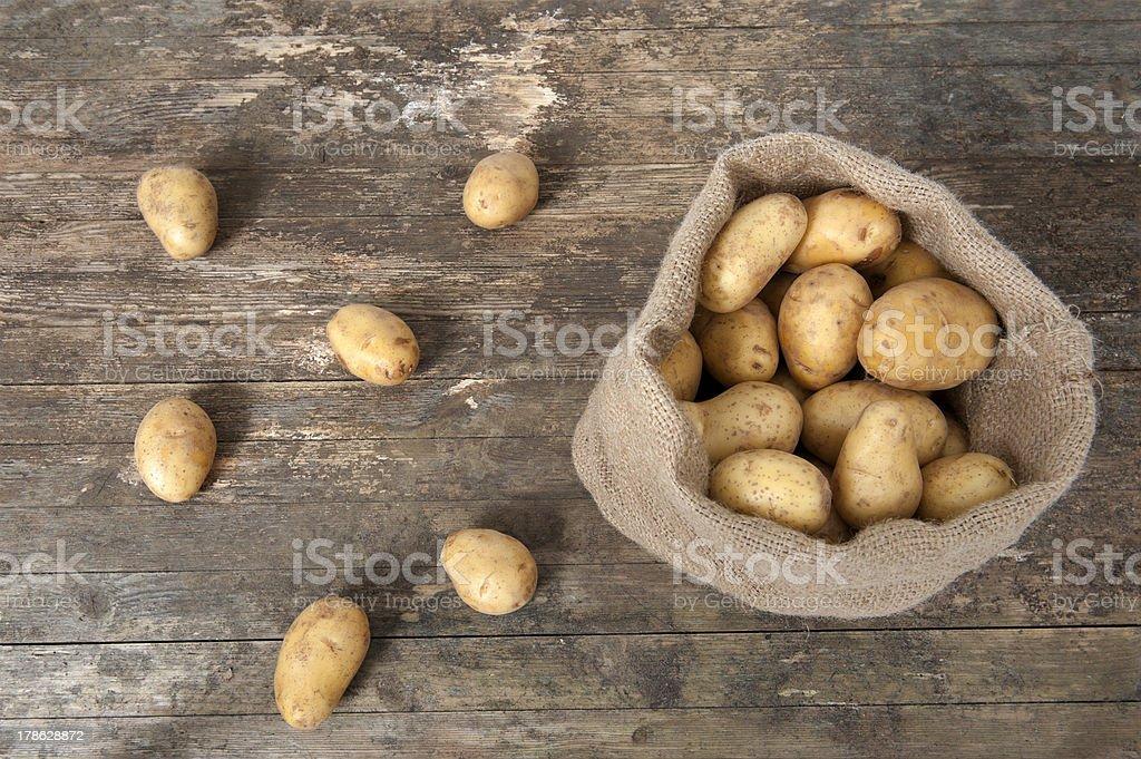 jute bag with potatoes stock photo