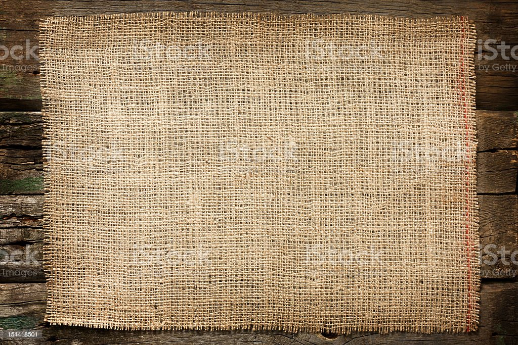 Jute canvas vintage background on boards stock photo