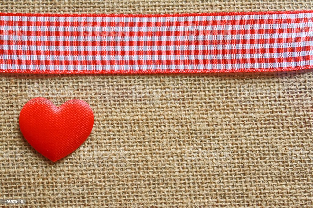 Jute, gingham and a heart stock photo