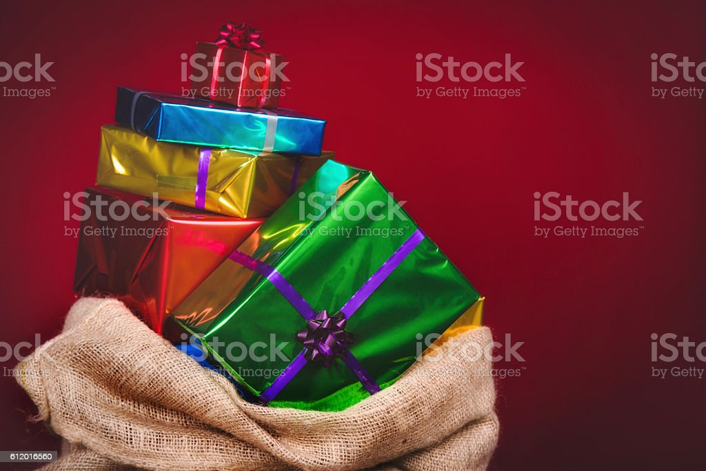 Jute Sack of saint Nicholas with presents stock photo