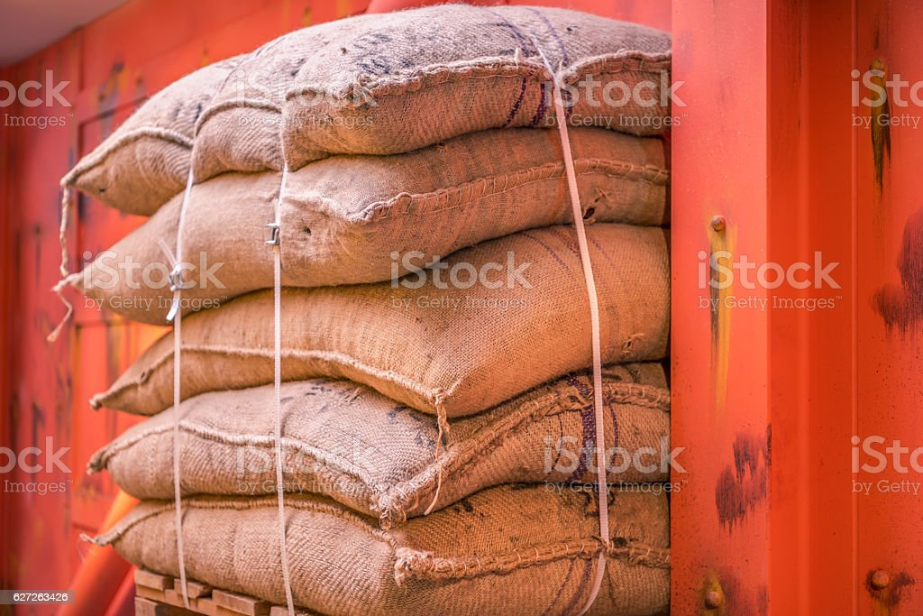 Jute sacks stacked in a warehouse stock photo