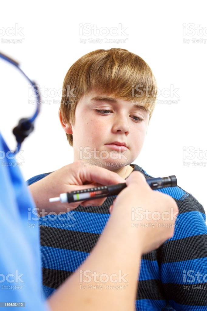 Juvenile diabetes patient being shown an insulin device royalty-free stock photo