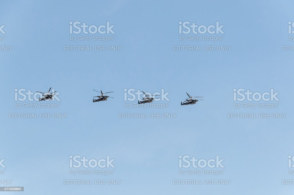 Ka-52 Alligator helicopters fly in rank against blue sky background royalty-free stock photo