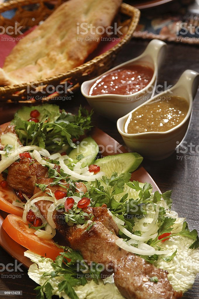 kabobs with sauce, fresh off the grill, georgian kitchen royalty-free stock photo
