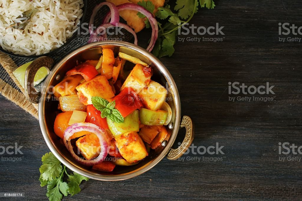 Kadai Paneer served with rice and Bhatura stock photo
