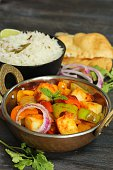 Kadai Paneer served with rice and Bhatura