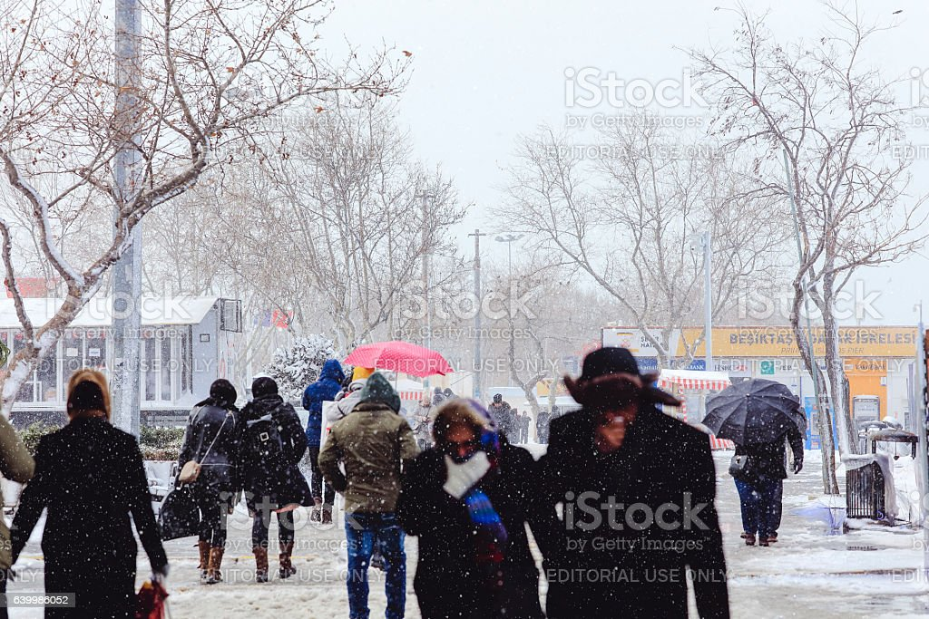 Kadikoy steamboat pier people walking in the snow stock photo