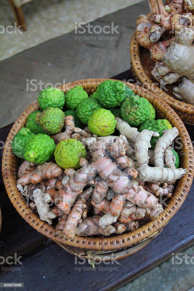 Kaffir Lime(Bergamot) and Ginger Root in baster stock photo