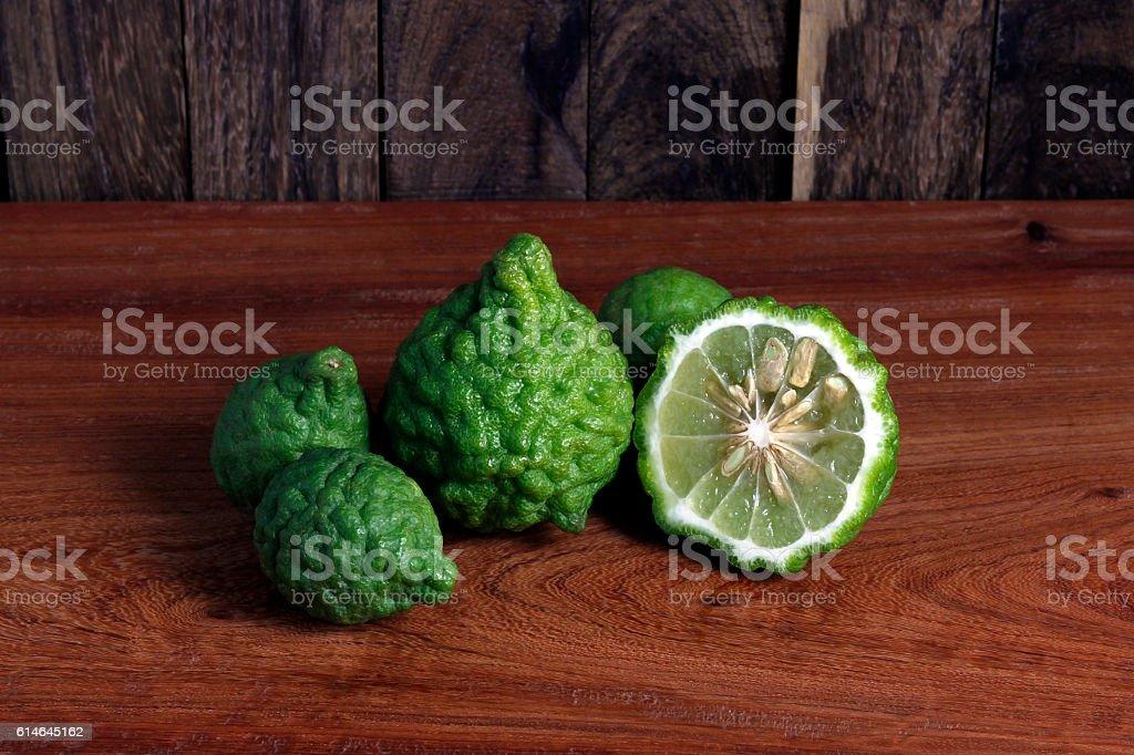 Kaffir lime, Bergamot bulb and cut on wood table and background. stock photo