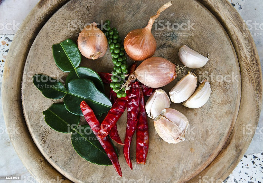 Kaffir lime leaves, shallots, garlic, dried chili and pepper. stock photo