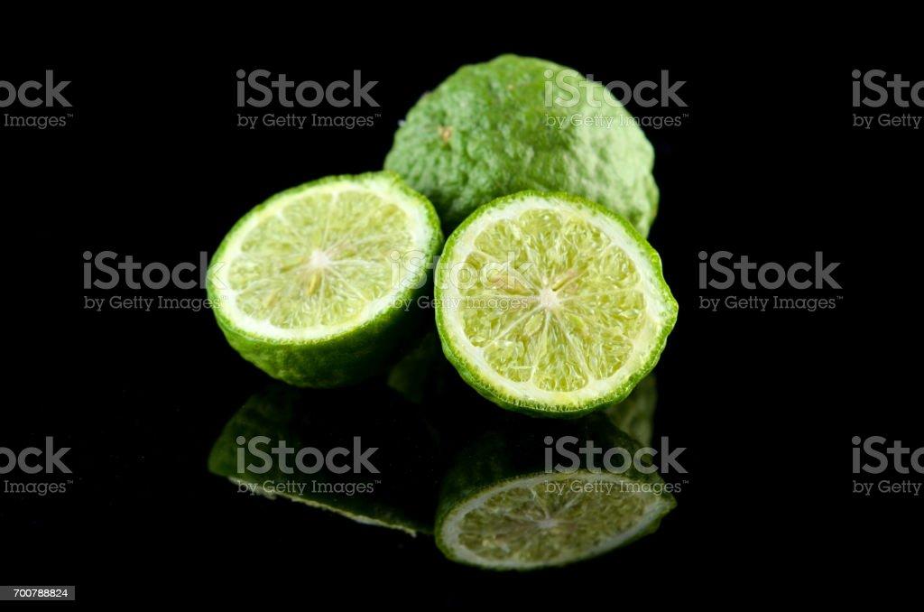 Kaffir Lime or Bergamot over black background stock photo