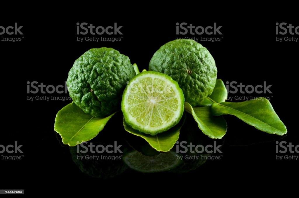 Kaffir Lime or Bergamot over black background stock photo