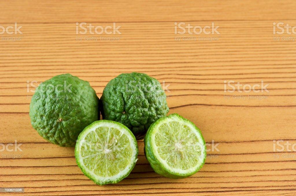 Kaffir Lime or Bergamot over wooden background stock photo
