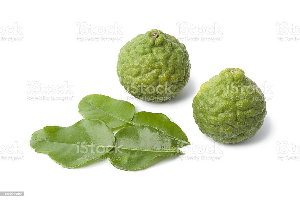 Kaffir limes and leaves stock photo
