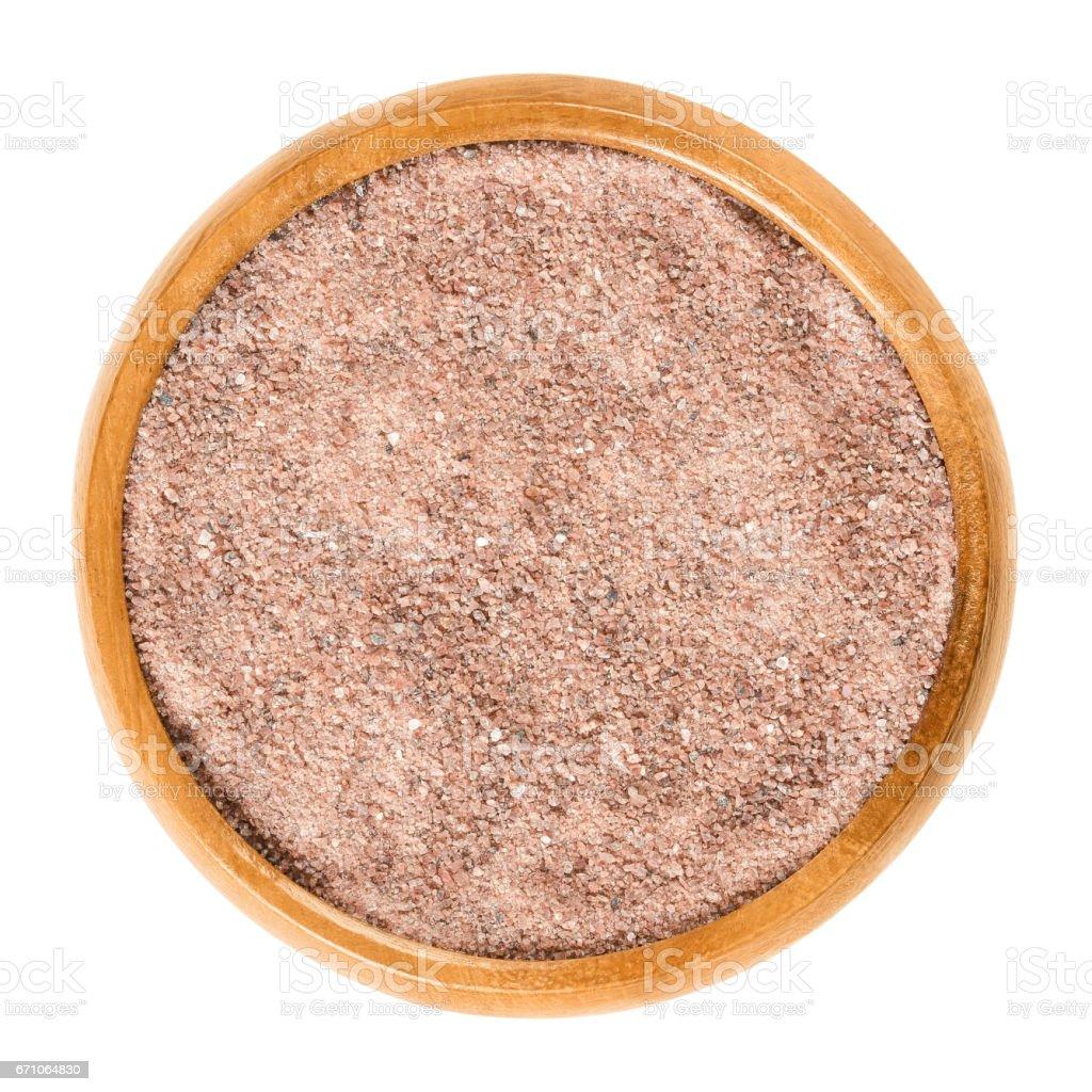 Kala Namak salt powder in wooden bowl over white stock photo
