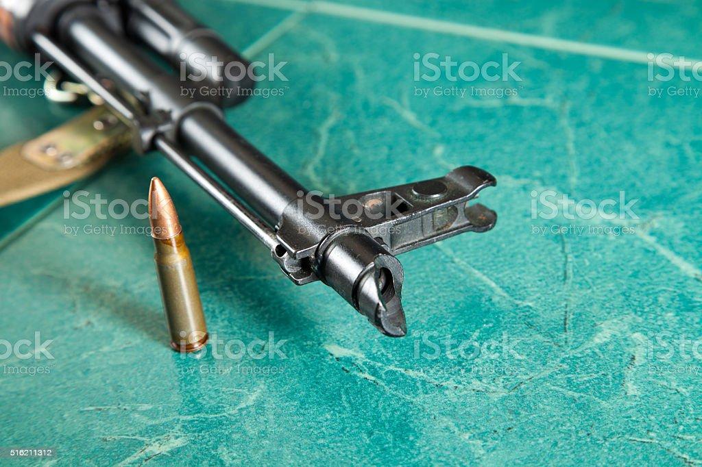 Kalashnikov AK-47 on a green background stock photo