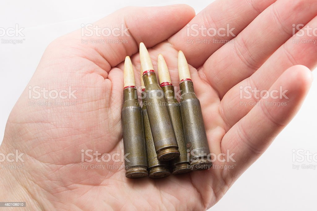 Kalashnikov bullets in a hand stock photo