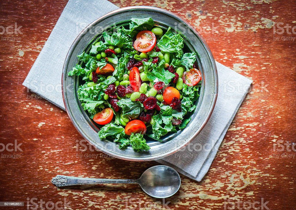 Kale and edamame salad on rustic background stock photo