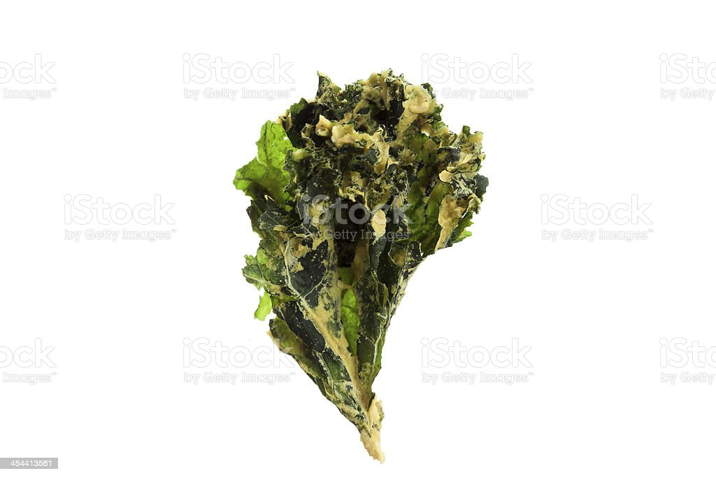 kale chip on white background royalty-free stock photo