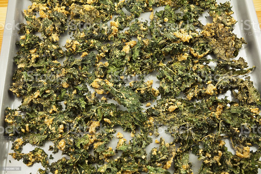 Kale chips on a baking sheet stock photo