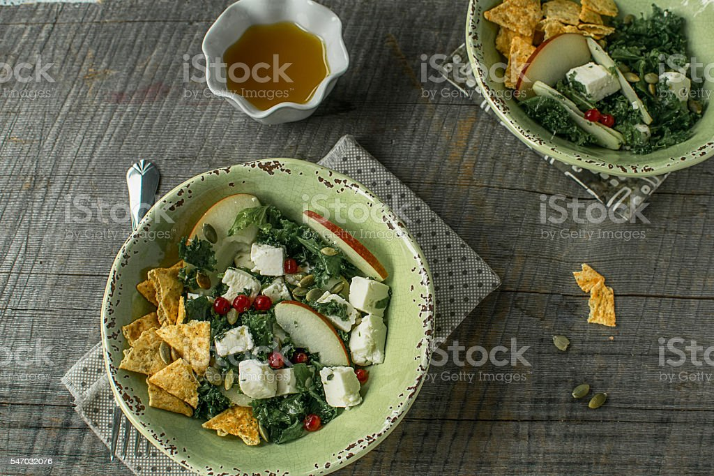 Kale, feta cheese, apple salad with corn chips stock photo