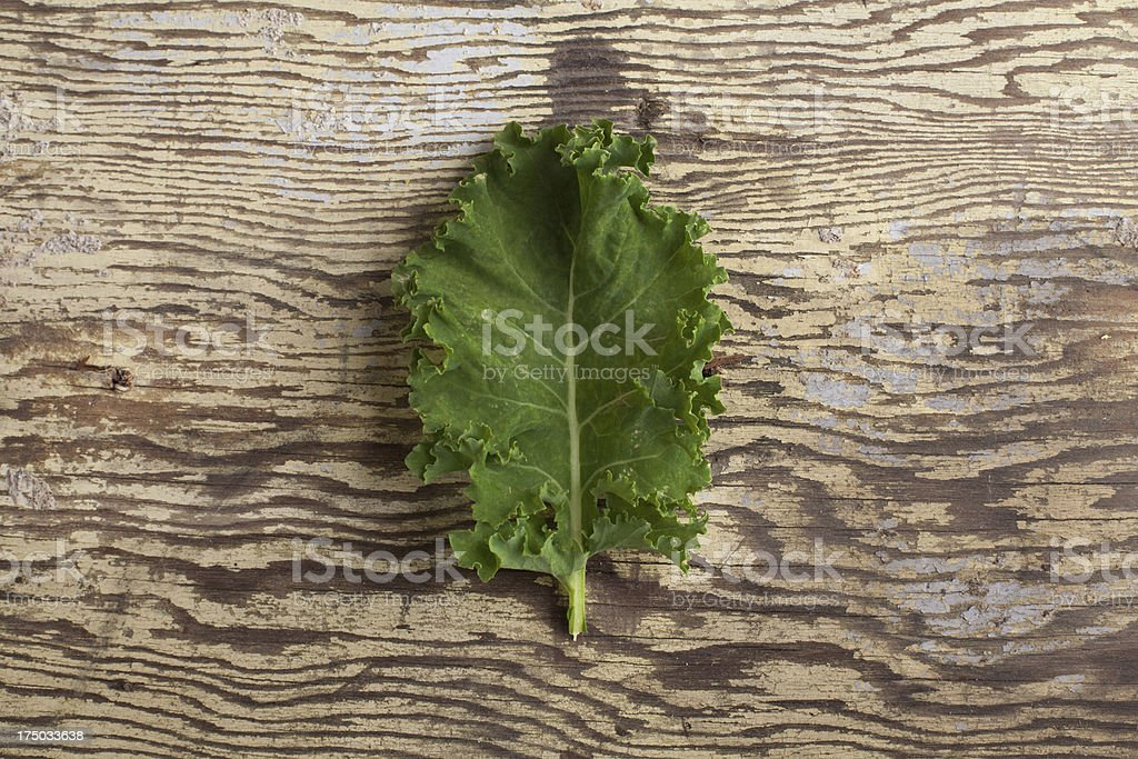 kale leaf on wood stock photo