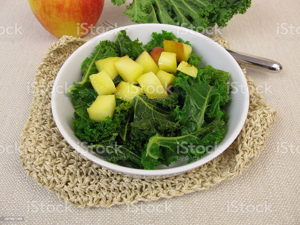 Kale salad with baked apple stock photo
