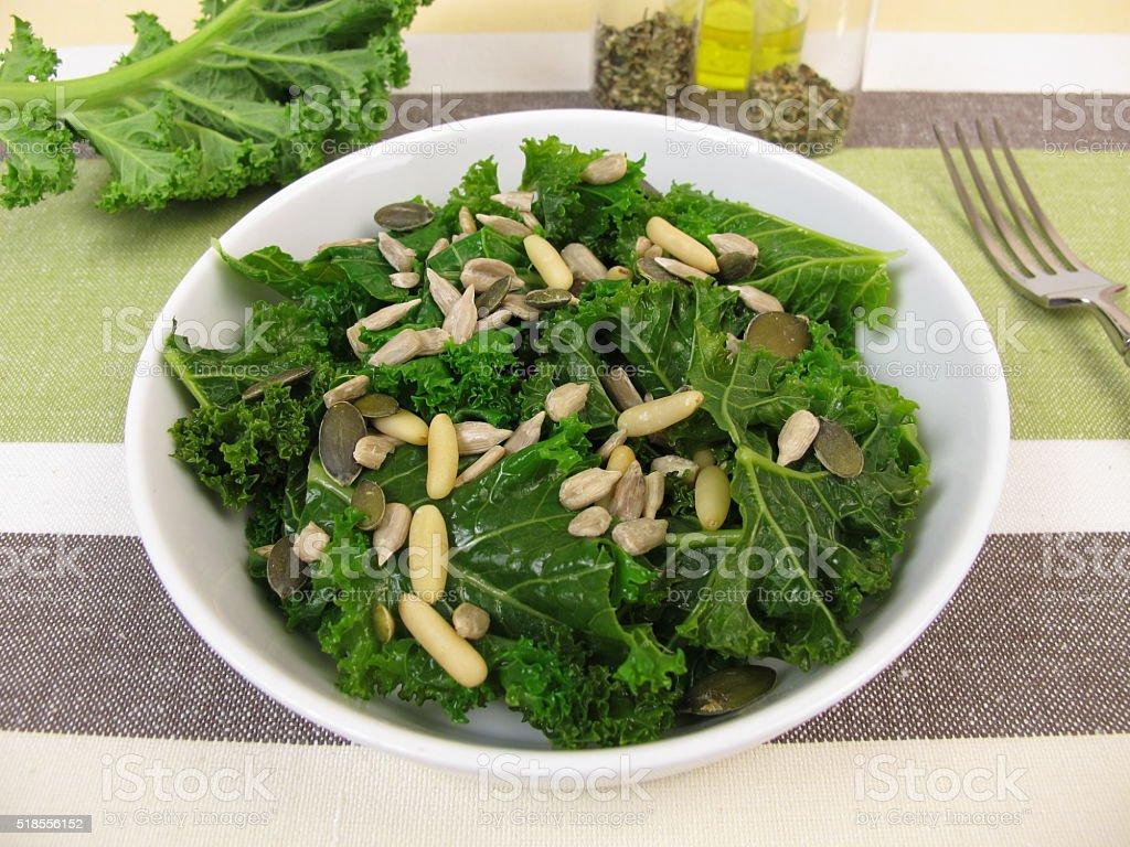 Kale salad with sunflower seeds, pine nuts, pumpkin seeds stock photo
