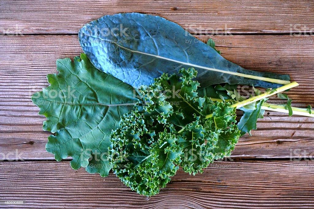 Kale Varieties on Wooden Background stock photo