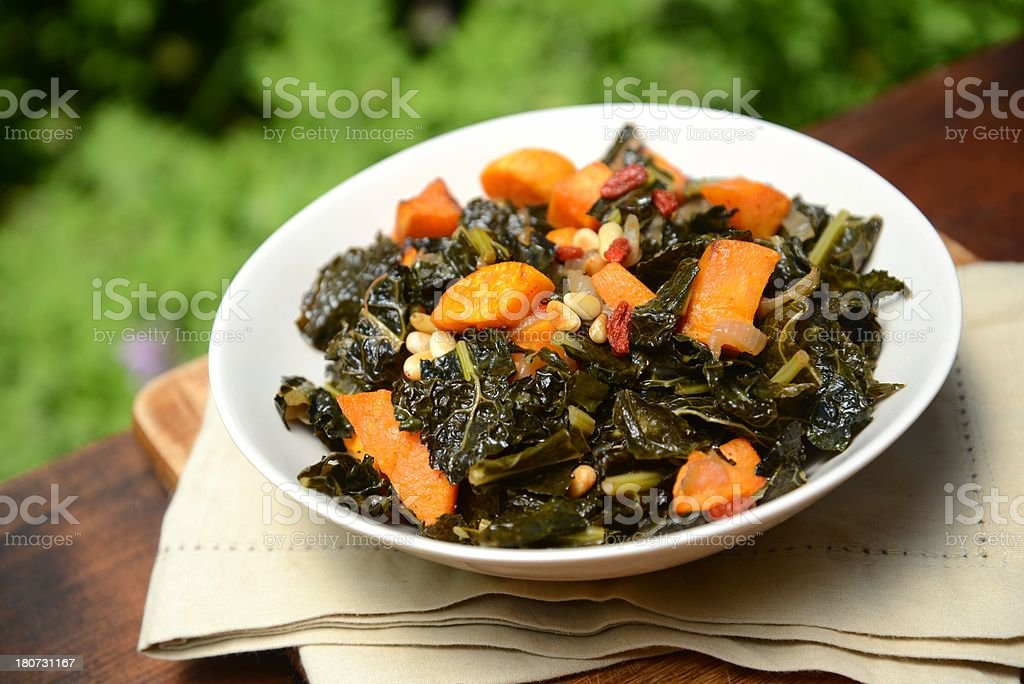 Kale with baked batata stock photo