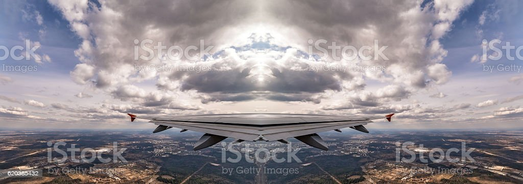 Kaleidoscopic pattern of aircraft wing above earth stock photo