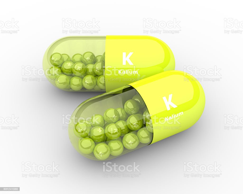 kalium pill with granules lying on table stock photo