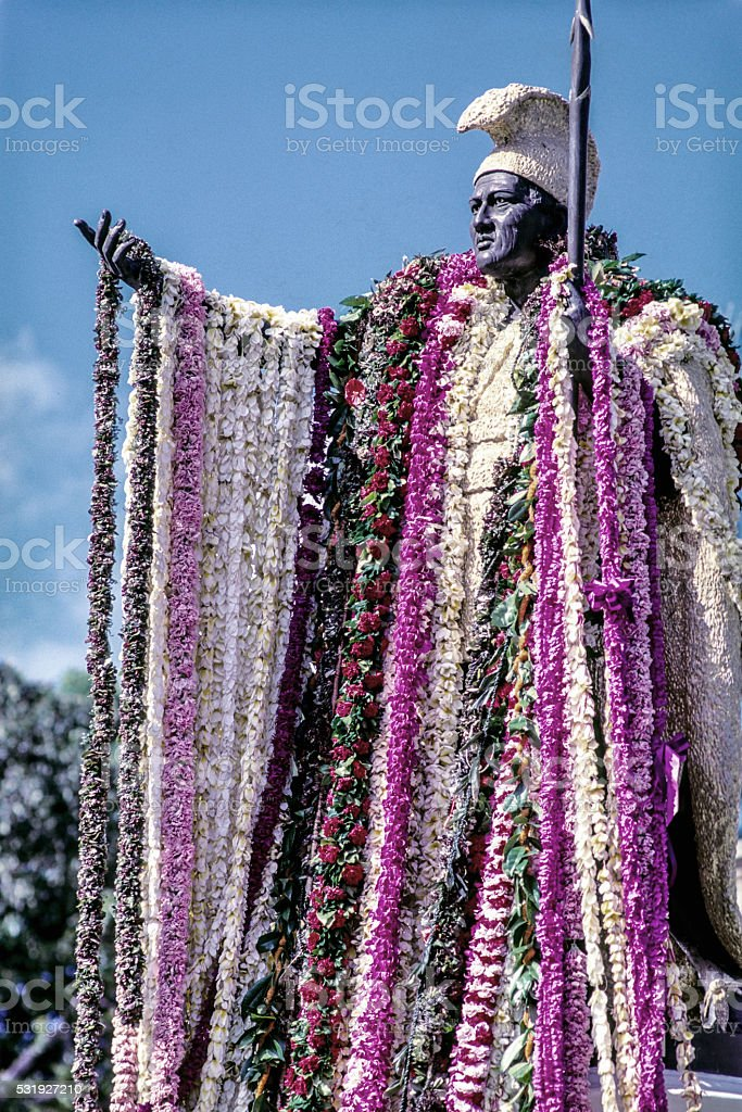 Kamehameha statue with flower leis stock photo