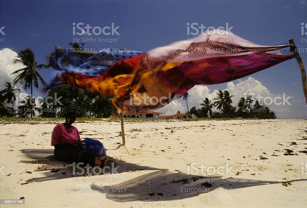Kanga beach seller at Diani beach, Kenya stock photo