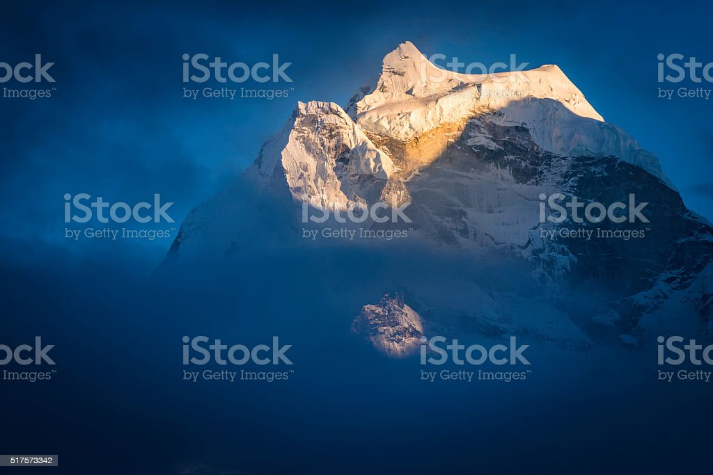 Kangtega 6782m Snow Saddle mountain summit at sunset Himalayas Nepal stock photo