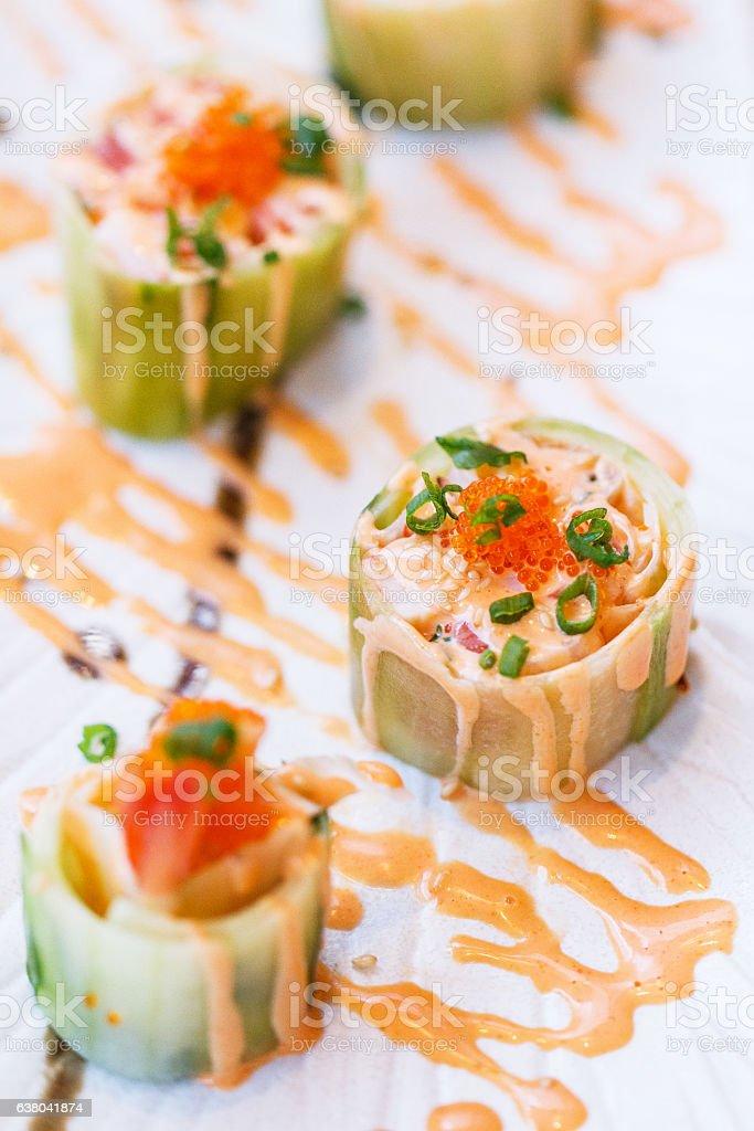 Kani and Maguro Maki Sushi Wraped with Sliced Cucumber. stock photo