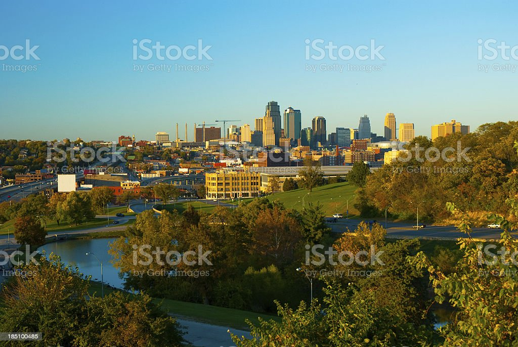 Kansas City skyline, trees, and a lake stock photo