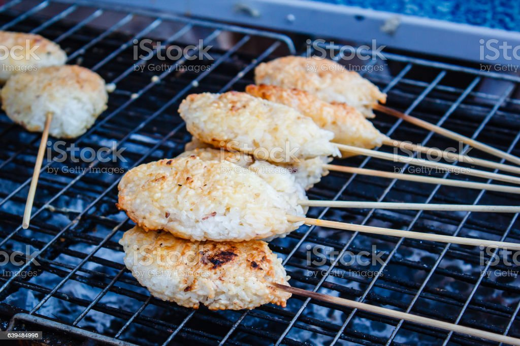 Kao Ji, grilled sticky rice dipped in egg. stock photo
