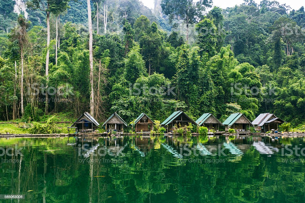 Kao Sok National Park lake and villagers sheds. stock photo