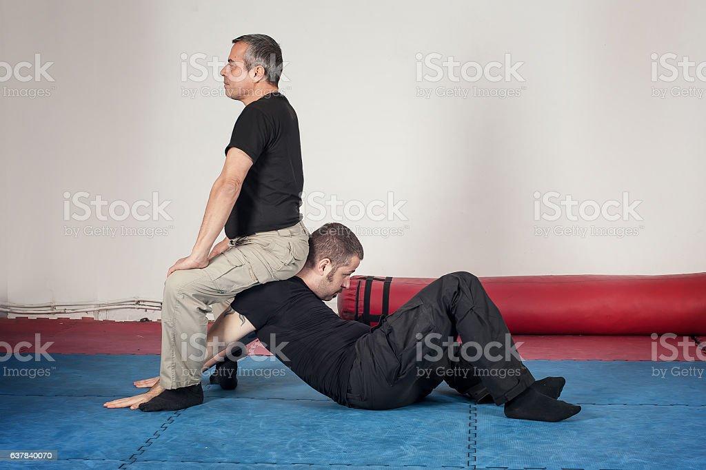 Kapap instructor demonstrates arm lock techniques stock photo