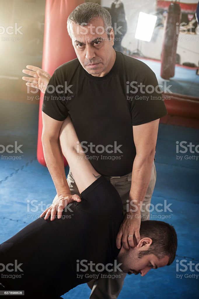 Kapap instructor demonstrates standing arm lock techniques stock photo