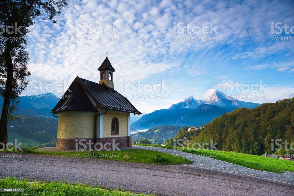 Kapelle in Berchtesgaden mit Watzmann und Nebel auf dem Königssee stock photo