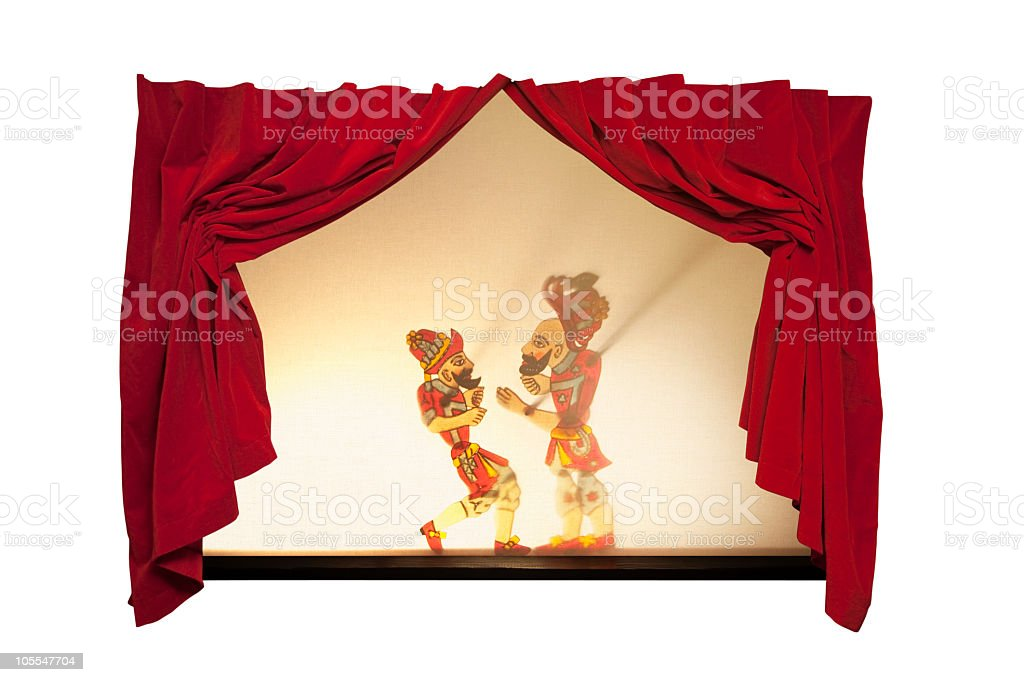 Karagoz and Hacivat on curtain-drawn stage royalty-free stock photo