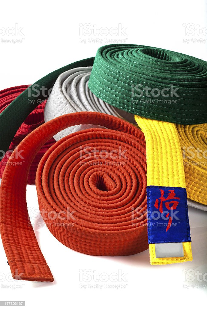 Karate belts on white portrait stock photo