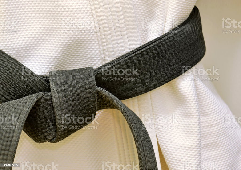 Karate Black Belt on White Uniform stock photo