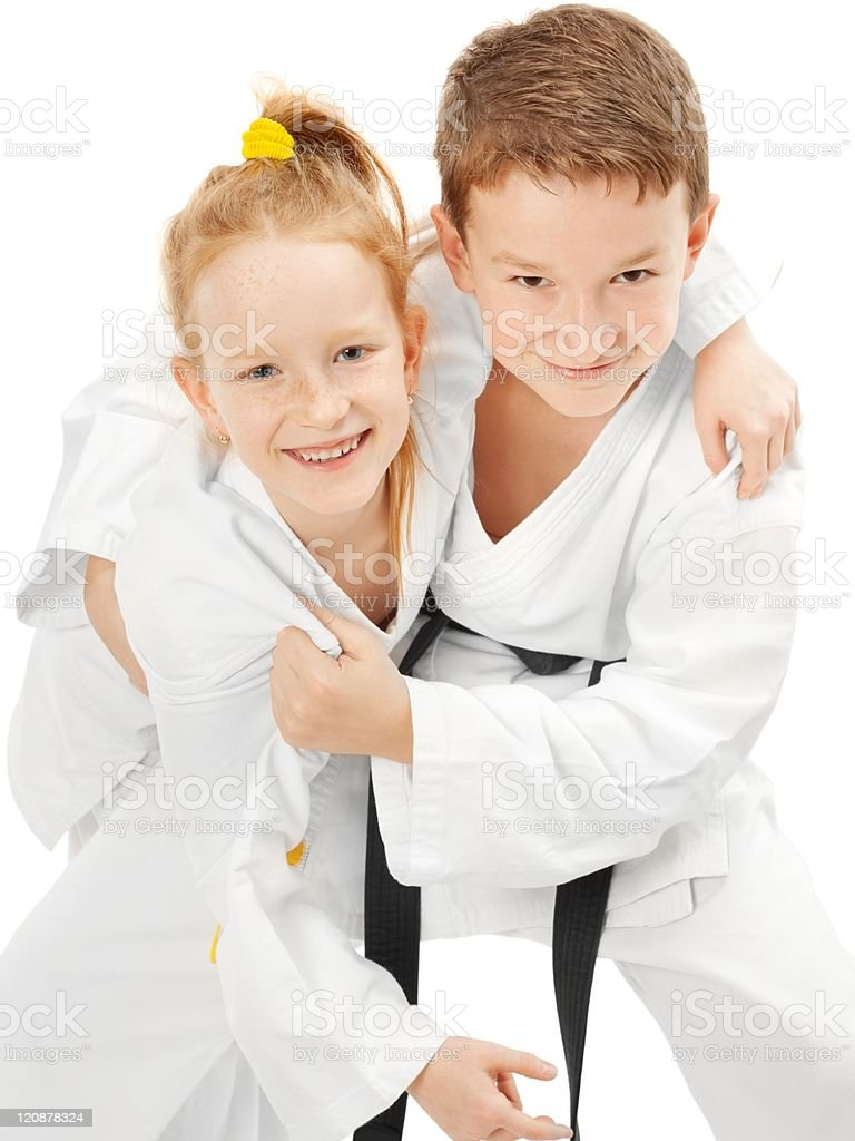 Karate boy and girl royalty-free stock photo