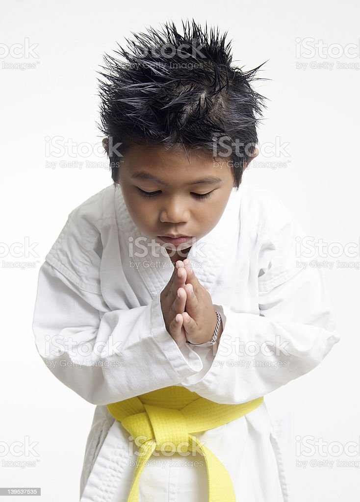 Karate boy bowing stock photo