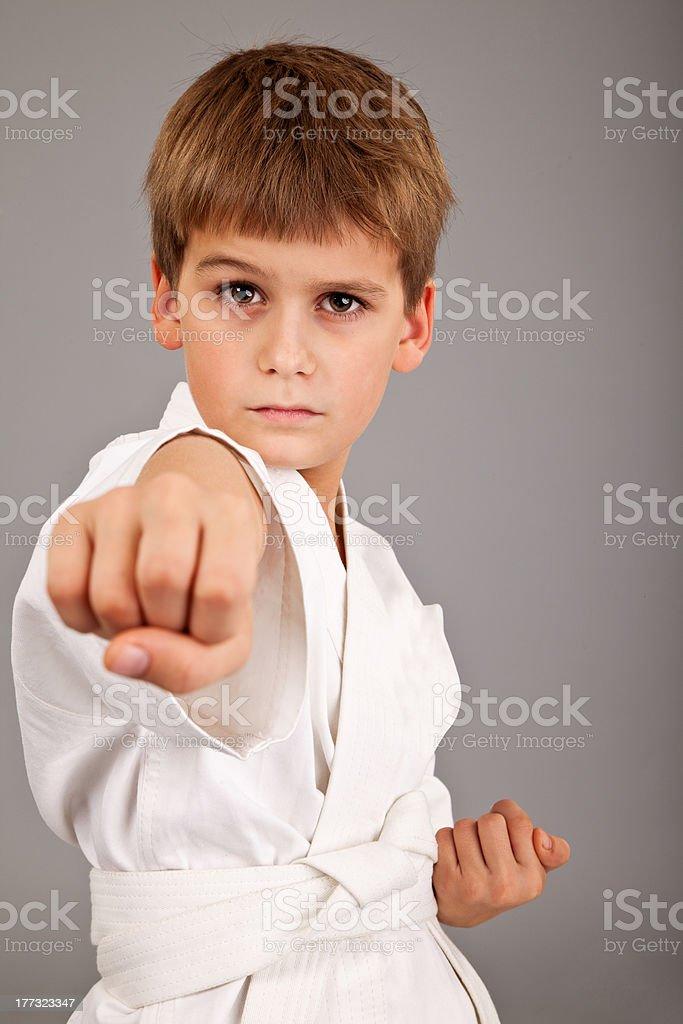 Karate boy in white kimono fighting royalty-free stock photo