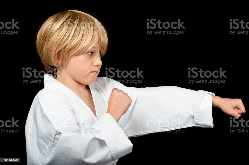 Karate boy punching stock photo